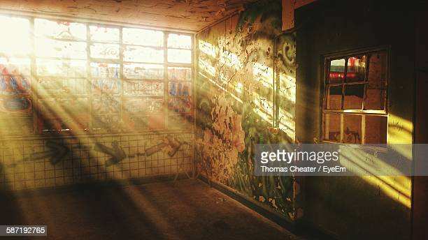 Sunlight Falling Through Windows In Abandoned House