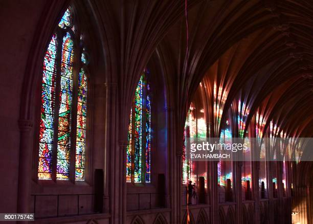 Sunlight filters through the stained glass windows inside the National Cathedral in Washington DC June 20 2017 There are 215 stained glass windows in...