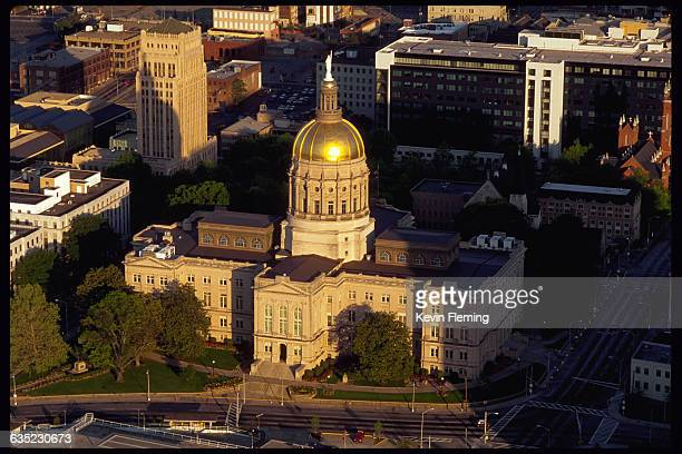 Sunlight gleams on the golden dome of the Georgia State Capitol building in Atlanta Georgia