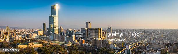 sunlight glinting from skyscraper overlooking city abeno harukas osaka japan - osaka prefecture stock pictures, royalty-free photos & images