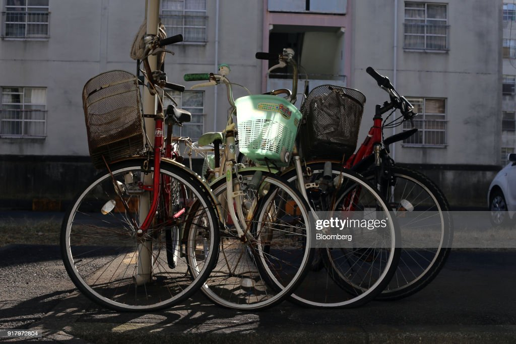 Sunlight illuminates a basket on a bicycle parked at a public housing complex in the Totsuka ward of Yokohama, Japan, on Sunday, Feb. 4, 2018. Japans economy expanded for an eighth quarter, with its gross domestic product (GDP) grew at an annualized rate of 0.5 percent in the three months ended Dec. 31, but the pace of growth fell sharply and missed expectations. Photographer: Takaaki Iwabu/Bloomberg via Getty Images