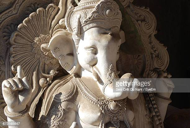 sunlight on ganesha sculpture - ganesha stock photos and pictures