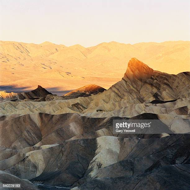 sunlight on manley beacon, zabriskie point - yeowell stock photos and pictures