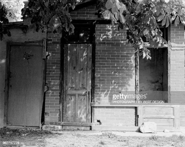 sunlight on old and broken house , entrevaux station - alpes de haute provence stock photos and pictures