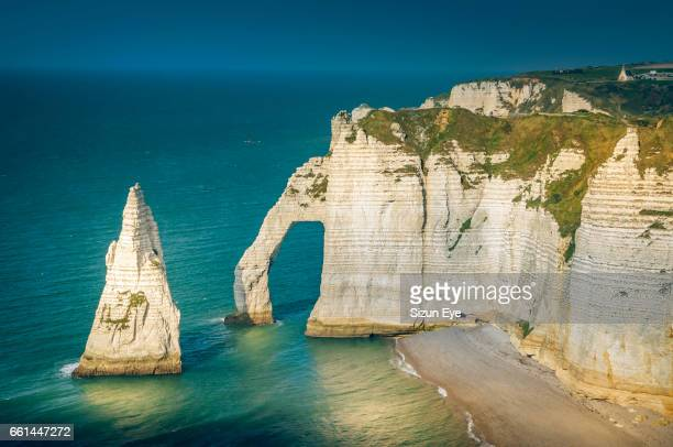 Sunlight on the white cliffs at Etretat in Normandy, France.
