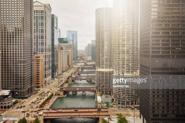 sunlight over downtown chicago river - chicago river stock pictures, royalty-free photos & images