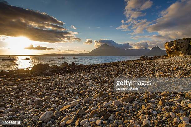 sunlight over elgol beach - pebble stock photos and pictures