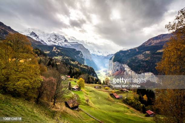 sunlight over valley, switzerland - tal stock-fotos und bilder