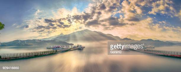 sunlight rays at sun moon lake in the moring, taiwan - taiwan stock photos and pictures