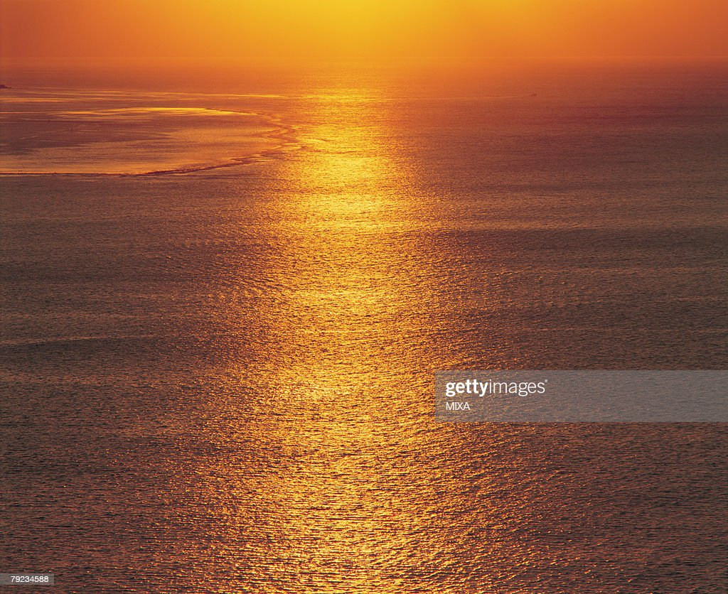 Sunlight reflected on surface of sea : Stock Photo