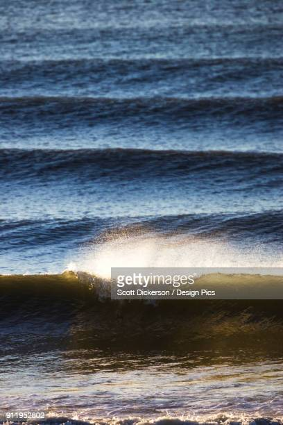 sunlight reflecting on the surface of the water and waves in kachemak bay - home run ストックフォトと画像
