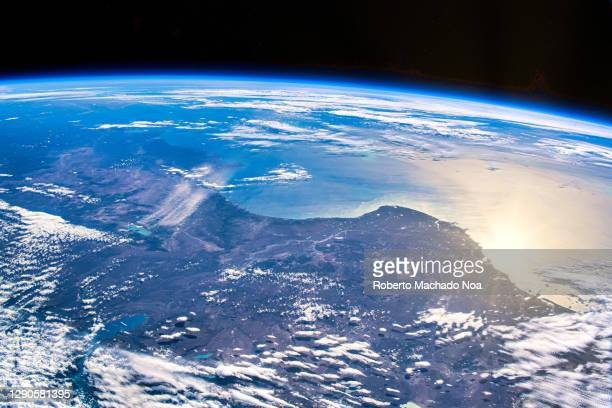 sunlight reflection over chile, iss point of view - atmosphere stock pictures, royalty-free photos & images