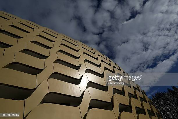Sunlight reflects off of the gold colored balconies of the InterContinental Hotel Davos operated by InterContinental Hotels Group Plc ahead of the...