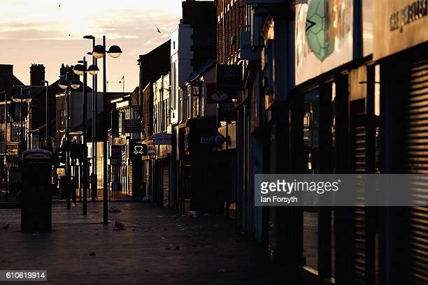Sunlight reflects on shop shutters in Redcar high street on September 27 2016 in Redcar United Kingdom One year on since the SSI steel making plant...