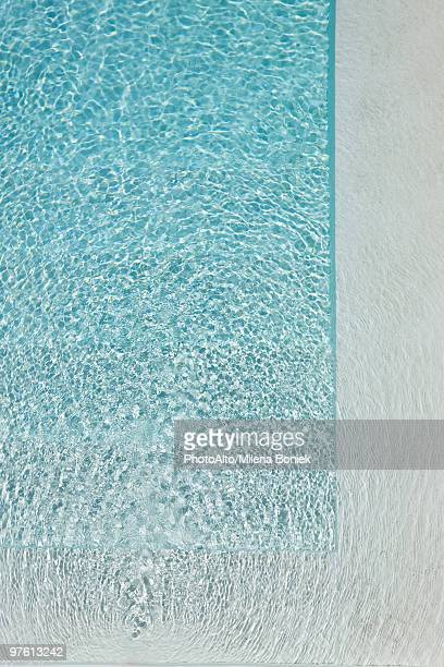 Sunlight refracted on water in swimming pool