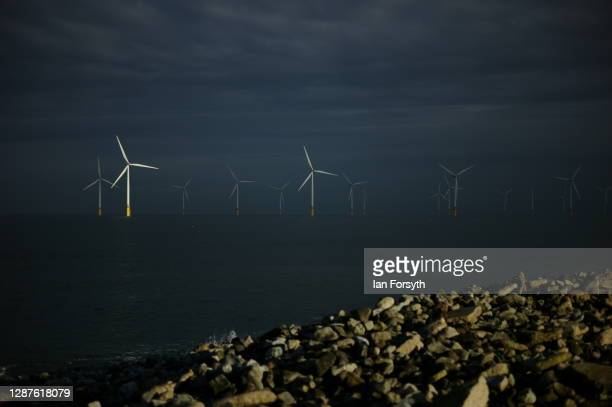 Sunlight shines from one of the EDF energy wind farm turbines near Redcar on November 25 2020 in Redcar England