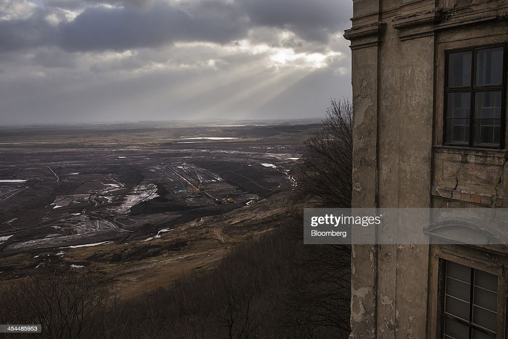 Sunlight shines on the open pit lignite mine, also known as brown coal, operated by Czech Coal AS seen from Jerezi Chateau near the town of Horni Jiretin, Czech Republic, on Friday, Dec. 6, 2013. The government may set up a joint company with Severni Energeticka that will seek lifting current environmental limits on lignite mining, Lidove Noviny reports, citing proposal submitted by Industry and Trade Ministry. Photographer: Bartek Sadowski/Bloomberg via Getty Images