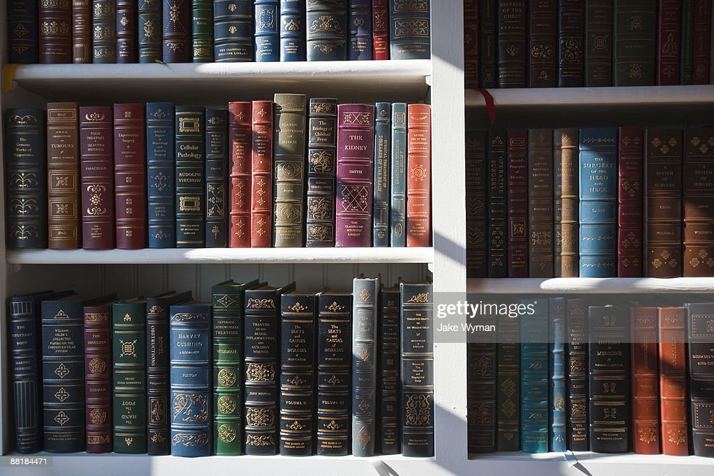 Sunlight shining on a library of books : Stock Photo