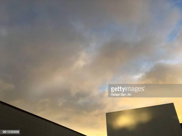 sunlight spot on a dark building wall - rafael ben ari bildbanksfoton och bilder