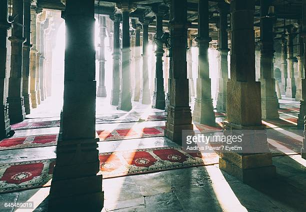 Sunlight Streaming Through Architectural Columns At Delhi Jama Masjid Mosque