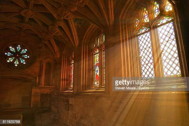 sunlight streaming through church window - katholicisme stockfoto's en -beelden