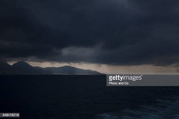 Sunlight Streaming Through Storm Clouds On Sea
