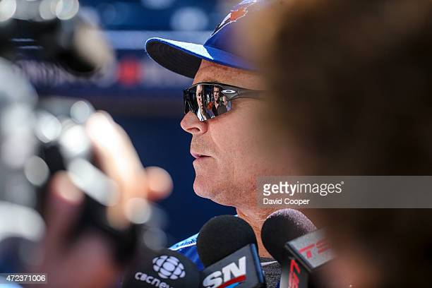 Sunlight streams onto the field as Jays manager John Gibbons talks to the media while the roof opens during batting practice before the game between...