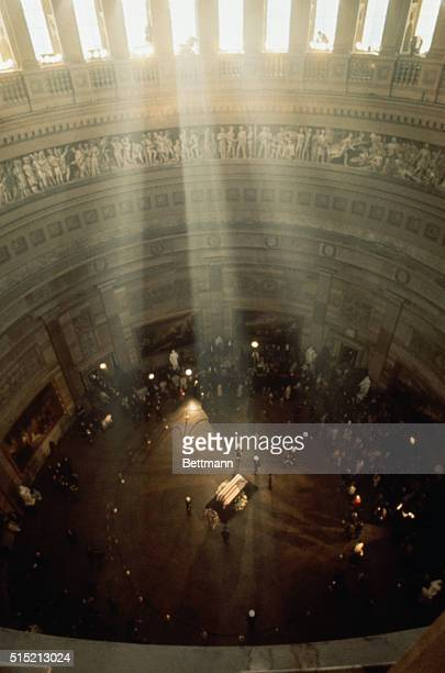 Sunlight streams through the columns of the The Rotunda of the US Capitol onto the coffin of the late President John F Kennedy The body of the...