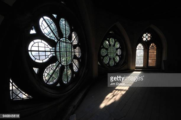Sunlight streams through the windows of the medieval Triforium above the nave of Westminster Abbey before it underwent restoration work on August 23...