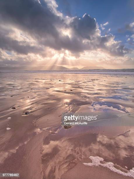 sunlight through cloud over ocean, inch, kerry, ireland - inch stock pictures, royalty-free photos & images
