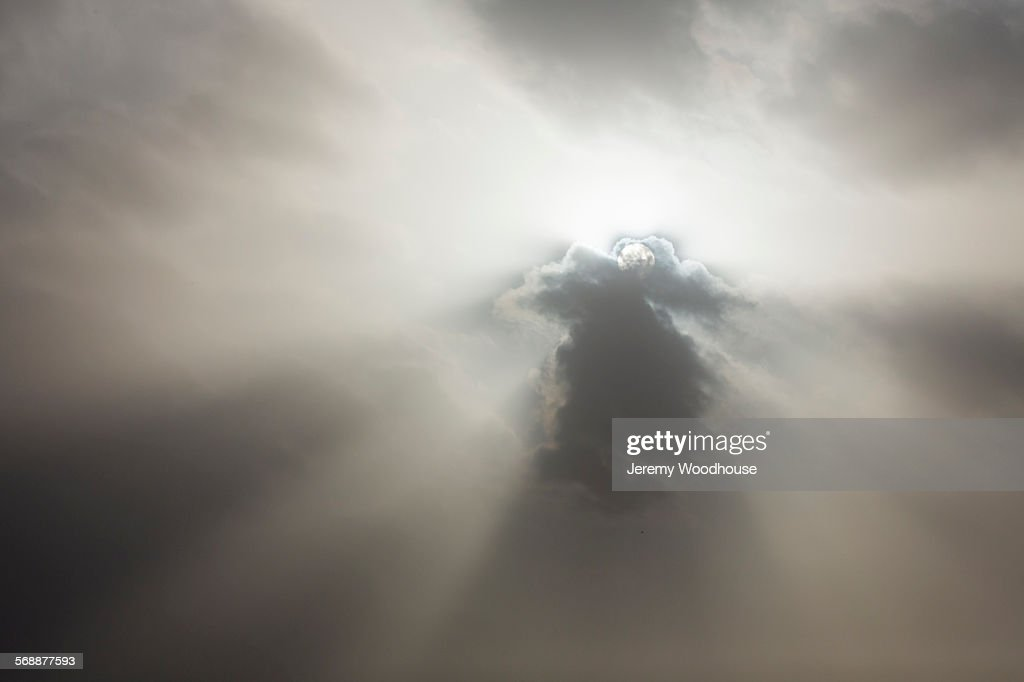 Sunlight through clouds : Stock Photo
