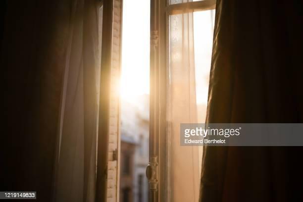 sunlight through the window during sunset - edward berthelot photos et images de collection