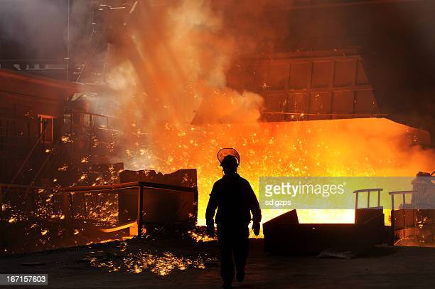 sunlight with iron worker - steelmaking stock photos and pictures
