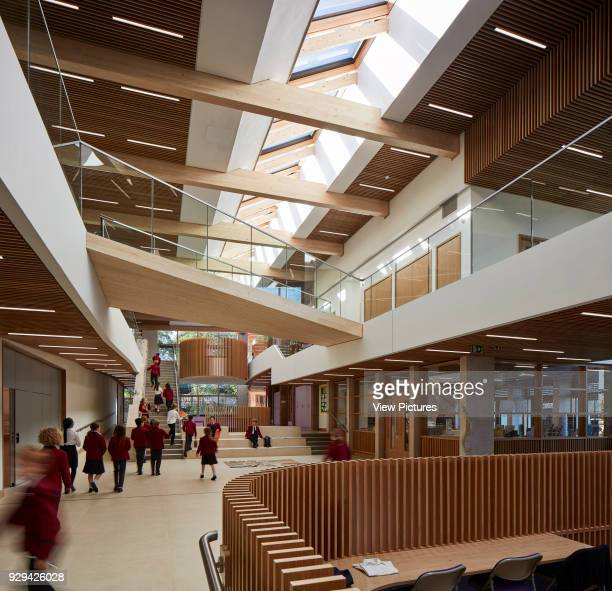 Sunlit atrium with students passing. Highgate Shool, London, United Kingdom. Architect: Architype Limited, 2016.