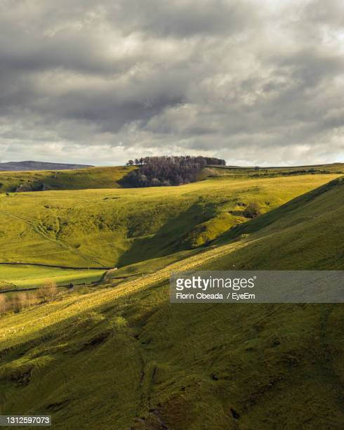 sunlit hills against the sky - weather stock pictures, royalty-free photos & images