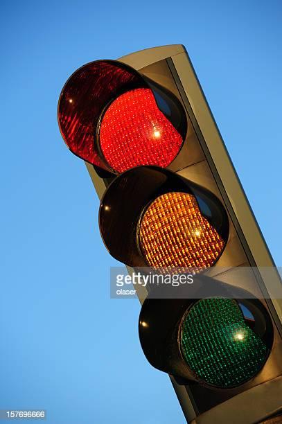 Sunlit red traffic light