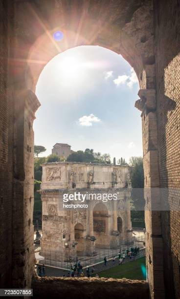 Sunlit view from Colosseum of the Arch of Constantine, Rome, Italy