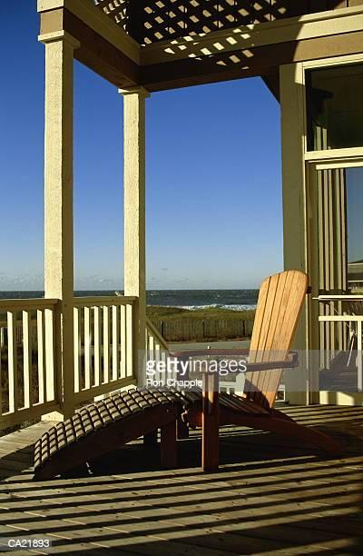 Sunlounger on veranda of beach house