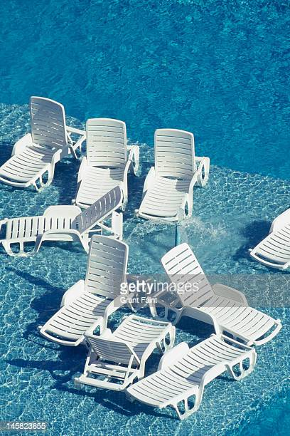 Sunloungers in a swimming pool
