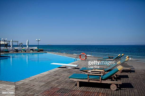 Sunloungers sit pool side at the swimming pool in the Lesbos in hotel on May 1 2010 on the island of Lesbos Greece Independent travel agency Sunvil...