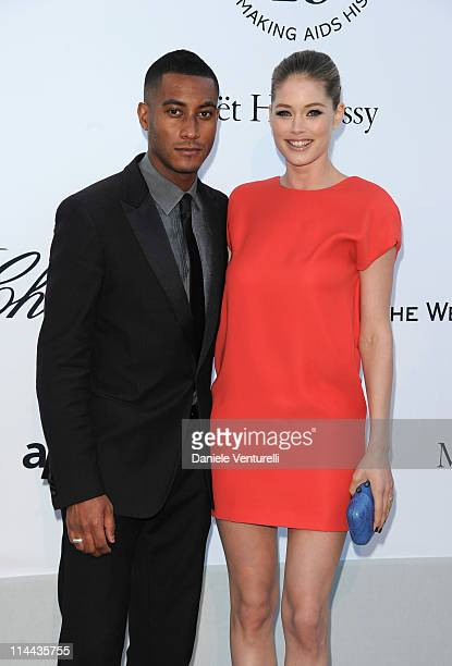 Sunnery James and Doutzen Kroes attend amfAR's Cinema Against AIDS Gala with L'Oreal during the 64th Annual Cannes Film Festival at Hotel Du Cap on...