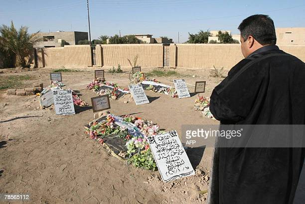 A Sunni Iraqi pays his respect at the tombs of late leader Saddam Hussein's relatives in the village of Awja near Tikrit 180 kms north of Baghdad 19...