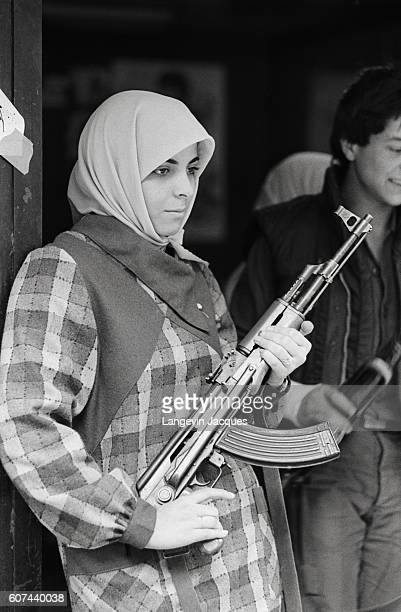 Sunni Mourabioun soldier holds her position in Beirut, Lebanon, shortly before the 1984 withdrawal of the Multinational Forces. In 1975, Lebanon fell...