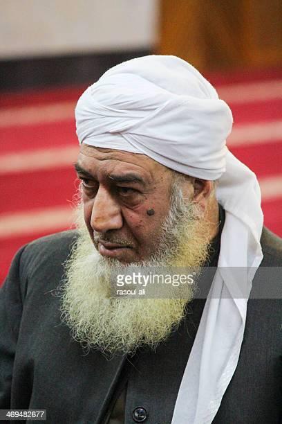 Sunni Muslim cleric .. Sunni community in Iraq .. Sunni sheikh Iraq .. Baghdad Photography Rasoul Ali