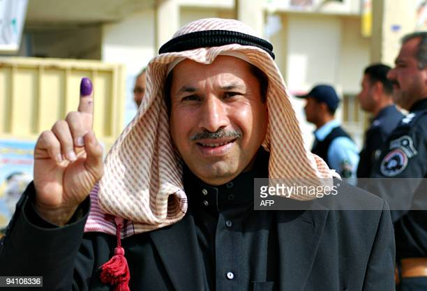 Sunni Muslim man shows his ink-stained finger after voting in the provincial elections in the western Anbar town of Ramadi, 100 kms from Baghdad on...