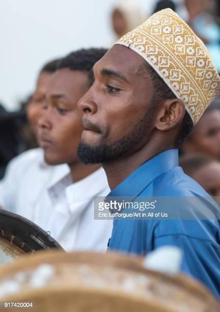 Sunni muslim men playing tambourines during the Maulidi festivities in the street Lamu County Lamu Town Kenya on December 16 2017 in Lamu Town Kenya