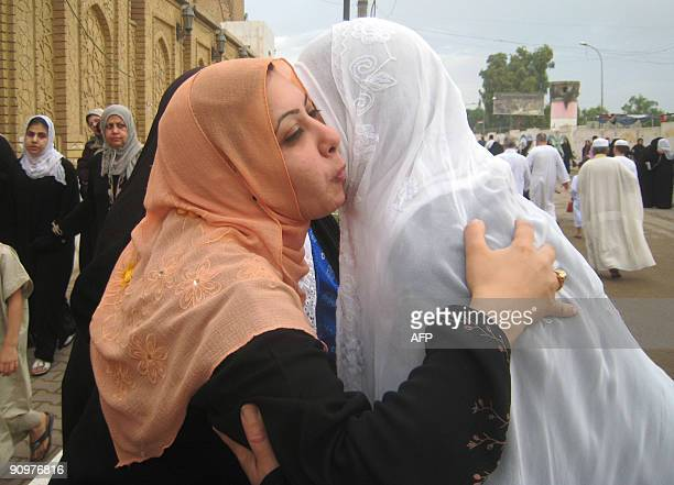 Sunni Muslim women wish each other happy Eid following dawn prayers on the first day of Eid alFitr marking the end of the holy month of Ramadan at a...