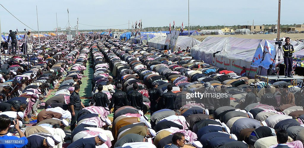 Sunni protesters hold a Friday prayer service on Iraq's main highway to Jordan. The protest againsts the Shiite-led government in Baghdad began at the start of the year and blocks the roadway.