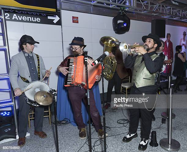 Sunniside Social Club band performs during 2nd avenue subway celebration at 72nd street station in Manhattan