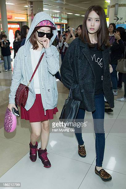 Sunny and Yoona of South Korean girl group Girls' Generation are seen upon arrival at the Gimpo Airport on October 28 2013 in Seoul South Korea
